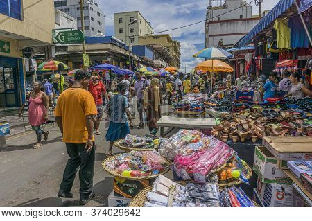 Port Louis, Mauritius, December 2015 - People At The Bustling Street Market Outside The Official Mar