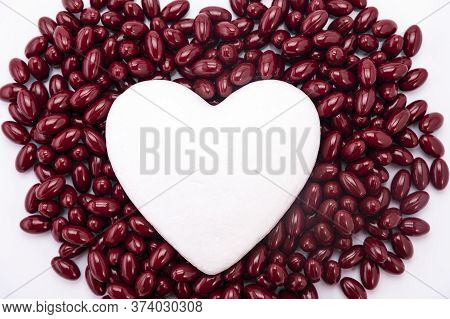 White Heart On Brown Pills. Pills From The Heart, Medical Concept
