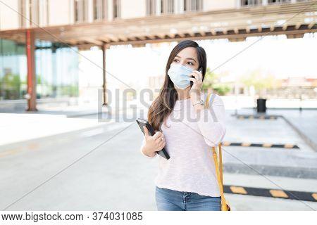 Caucasian Mid Adult Woman Talking On Mobile Phone During Coronavirus Crisis