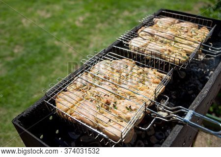 Chicken Breast Grilled With Flames. Marinated Chicken Wings And Legs Grilling On A Summer Barbecue W