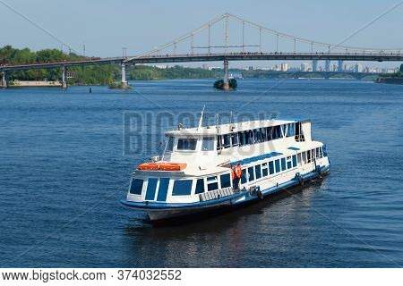 Cruise Ship Sails Along The River. Navigation On The Dnieper. Weekend Walks.