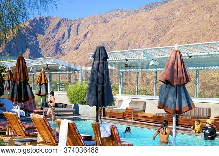 June 22, 2020 In Palm Springs, Ca:  People Sunbathing And Swimming At The Rooftop Pool Taken In The