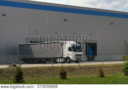 Place Loading And Unloading  Trucks. A Truck During Unloading In A Distribution Center.