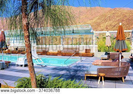 June 22, 2020 In Palm Springs, Ca:  Manicured Plants And Modern Style Seating Surrounding A Rooftop