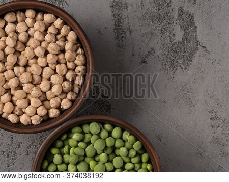 Green Peas And Chickpeas In A Brown Pot. The Gray Background.