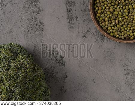 Mung Beans And Broccoli On A Gray Background.