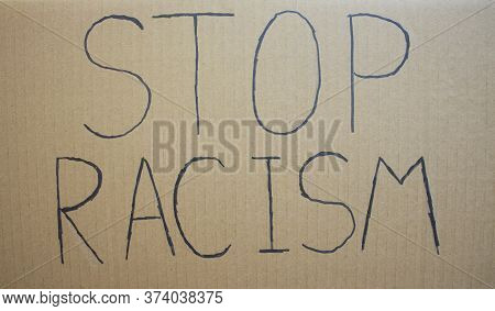 Stop Racism. Text Message For Protest On Cardboard. Stop Racism. Police Violence. Banner Design Conc