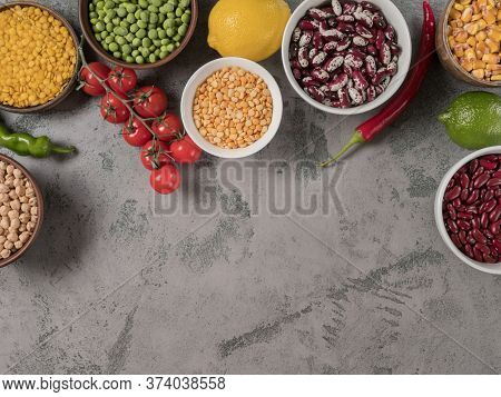 Set Beans And Healthy Vegetables For Cooking. The Gray Background.