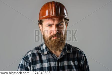 Bearded Worker In Hard Hat. Builder Concept. Building, Industry, Technology. Builder In Hard Hat. Po