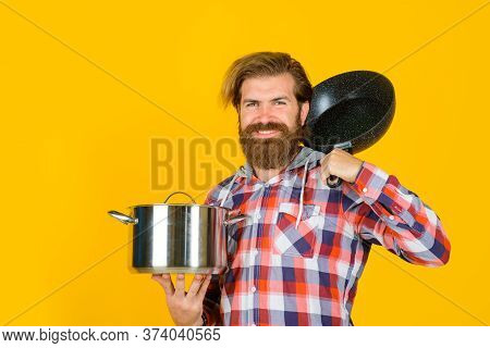 Kitchenware. Kitchen Advertising. Bearded Man With Saucepan Frypan. Man Chef With Pot. Saucepan. Coo