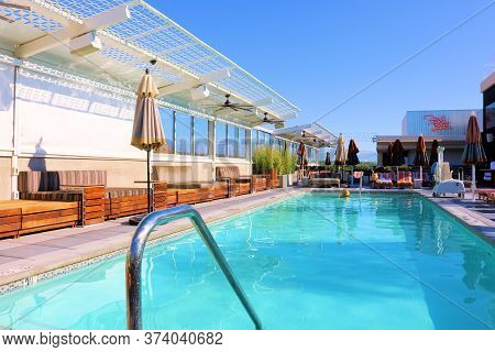June 22, 2020 In Palm Springs, Ca:  Contemporary Style Furniture Surrounding A Rooftop Pool With A P