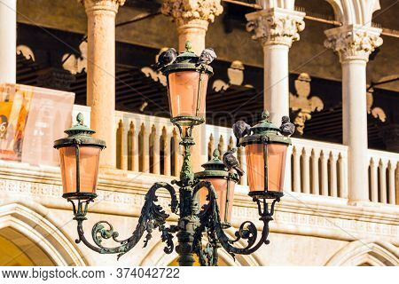 Decorative street lamps and facade decorative elements. Doge's Palace. Magical journey to Venice. Palazzo Ducale in Piazza San Marco. The concept of educational, cultural and photo tourism