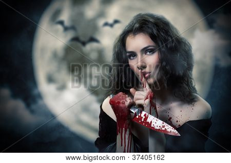 Young beautiful witch. Halloween day