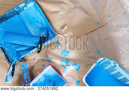 House Renovation Tools In Blue Paint Stains On Brown Craft Paper, Do It Yourself Renovations