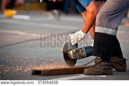 Metal Cutting. Metal Cutting With Angle Grinder.man Cuts Metal.