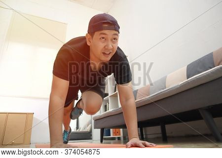Asian Male Doing Exercise At Home To Stay Healthy On New Normal Lifestyle, Indoor Home Workout Conce