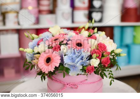 Blooming Flower Arrangement In A Hat Box In A Flower Shop. Vegetable Natural Holiday Gift. Small Bus