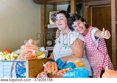 Croatia, Split - September 22th, 2018: Two Female Sellesr Having Fun At Their Grocery Store In A Pub