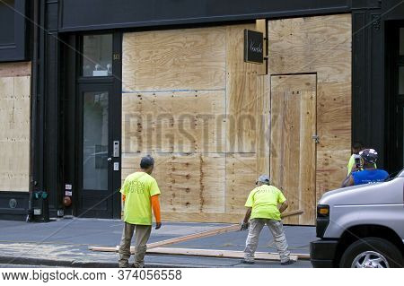 New York, New York/usa - June 2, 2020: Men Board Up Their Business To Prevent Looting During Black L