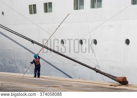 Corfu, Greece - October 1th, 2018: A Seaman - Seafarer With Safety Clothes Washing The Windows Of A
