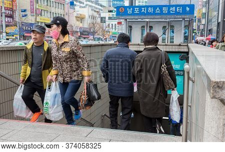 Busan, South Korea - March 27th, 2017: Korean Passengers Are Going Out Of The Metro With Surgical Ma