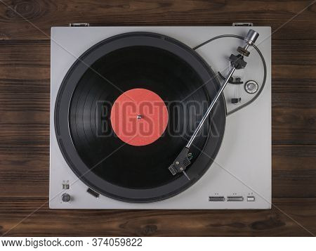 Vinyl Record Player On A Wooden Background. The View From The Top. Music On Vinyl Discs.