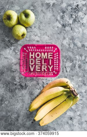 Online Grocery Shopping, Shopping Basket With Home Delivery Text In It And Fruit Next To It