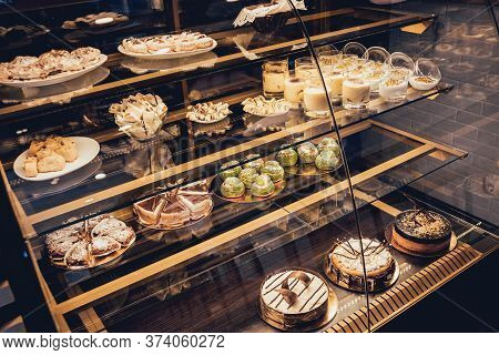 Sweets And Cakes In Showcase. Italian Pastry Shop.