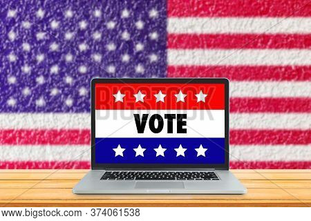 Online Election And Us Election Concept : Vote Text Wording On Laptop Display With Usa Flag In Backg