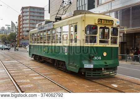 Nagasaki, Japan - March 26th, 2017: The Tram-train In Nagasaki Operated By The Nagasaki Electric Tra