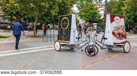 Larissa, Thessaly, Greece - May 4th, 2018: Two Tricycles With Advertisement Billboards Placed On The