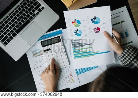 Close Up Businessman Using Calculator And Laptop For Calculating Finance, Tax, Accounting, Statistic