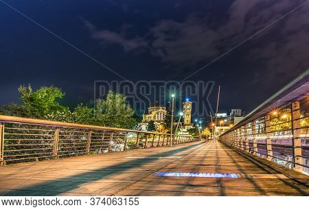 Larissa, Thessaly, Greece - May 22th, 2018: View Of The Sidewalk Of The Pinios Bridge At Night On Th