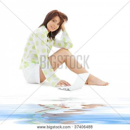 woman with laptop computer on white snad