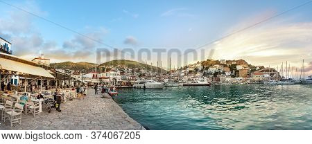 Hydra, Greece - October 4th, 2018: Panoramic View Of The Waterfront And Their Commercial Center In H