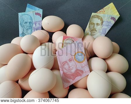 Price In Consumption And Production Cost Of Egg, Costa Rican Banknotes And Heap Of Organic Chicken E