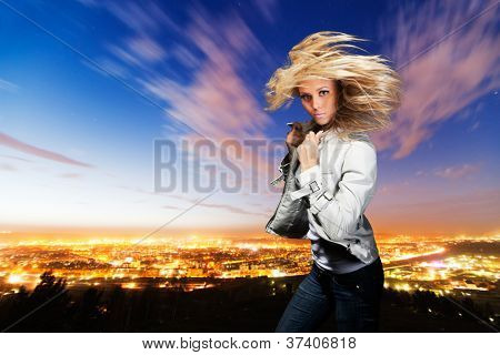 Portrait of the girl with  flyaway hair in the background of city