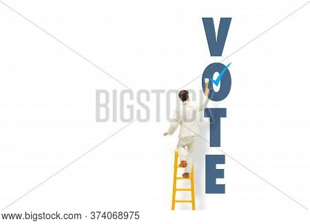 Voting Concept : Painter Standing On Ladder And Painting Blue Tick Checkbox On Vote Text Wording On