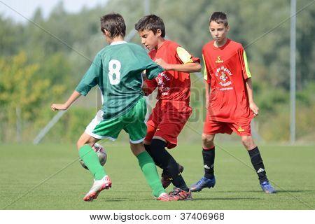 KAPOSVAR, HUNGARY - SEPTEMBER 22: Daniel Galambos (green 8) in action at the Hungarian Championship under 15 game between Rakoczi (green) and Mezga FC (red) September 22, 2012 in Kaposvar, Hungary.