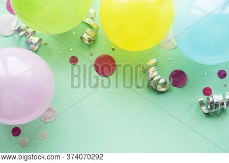 Happy Birthday Or Party Background.  Flat Lay Wtih Birthday Balloons , Confetti And Ribbons On Paste