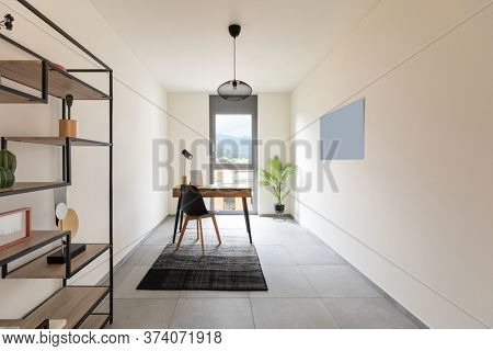 Interior study or home office with table and chair. Minimalist but nice decor.