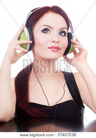 Portrait of attractive young adult woman listening music with mp3 player, isolated on white