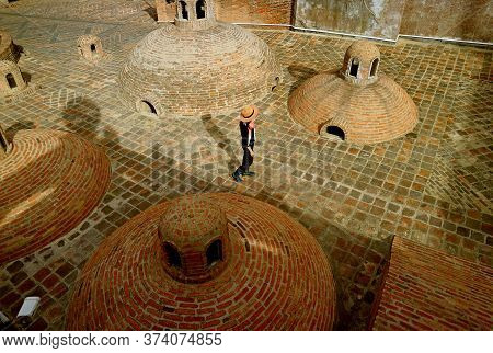 Female Traveler Enjoying The Iconic Medieval Sulfur Baths In The Old Tbilisi, Historical Place In Ge