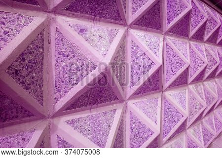 Diminishing Perspective Of Purple Pink Colored Geometric Concrete Wall For Abstract Background