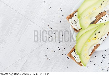 Fresh Spring Vitamine Sandwiches Of Flat Cereal Rye Dry Crisps Bread With Avocado Slices, Olive Oil,