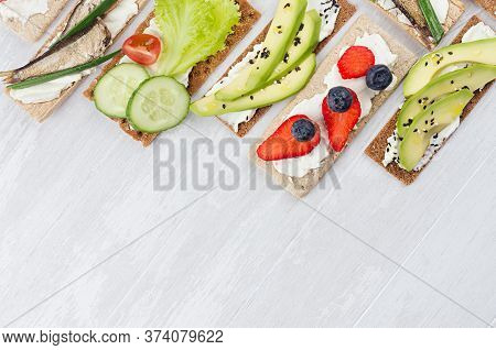 Fresh Spring Vitamine Sandwiches Of Flat Cereal Rye Dry Crisps Bread With Vegetables, Ripe Fruits, F