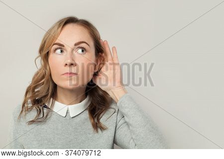 Careful Woman Listening Business News And Gossips On White Background