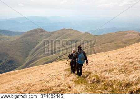 Traveling Outdoor Hiking In Nature. People Hiking In Mountain. People Hiking Outdoor In Nature. Natu