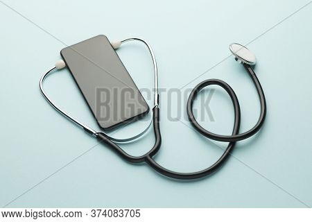Smartphone And Stethoscope On Blue Background. Online Medicine (telemedicine) Technology. Service Fo