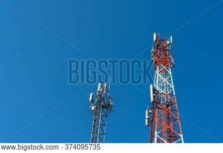 Telecommunication Tower With Clear Blue Sky. Antenna On Blue Sky. Radio And Satellite Pole. Communic